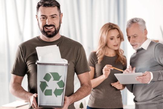 Content man holding a litter bin