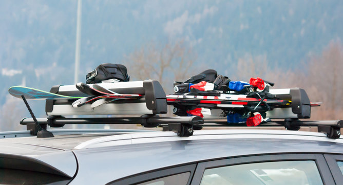 Luggage rack with ski and snowboard on a car