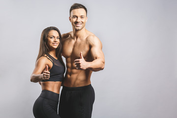 Athletic man and woman isolated over white background. Personal fitness instructor. Personal...