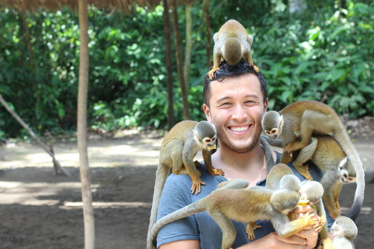 Handsome ethnic man with titi monkeys