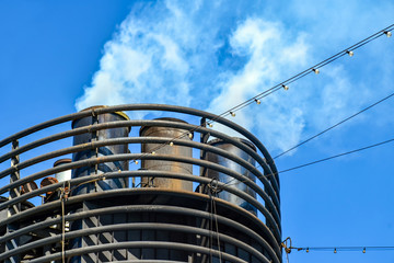 From the chimney of a cruise ship escape smoke and exhaust fumes