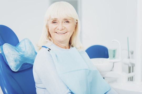 Optimistic senior woman smiling to camera
