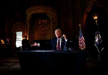 U.S. President Donald Trump speaks via video teleconference with troops from Mar-a-Lago estate in Palm Beach