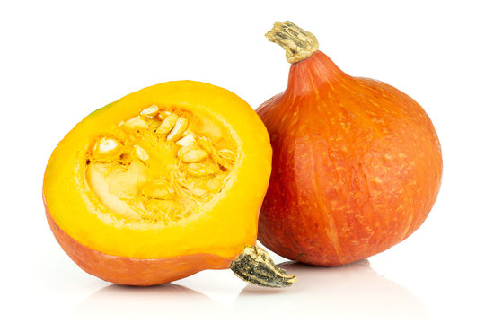Group of one whole one half of fresh red kuri pumpkin hokkaido variety with seeds isolated on white background