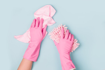 Female hands cleaning on blue background. Cleaning or housekeeping concept background. Copy space.  Flat lay, Top view.