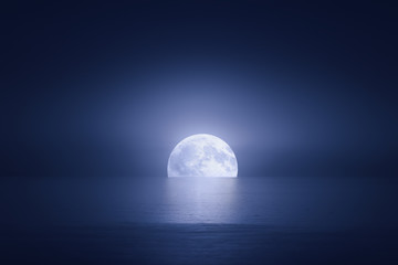 big moon over the sea at night