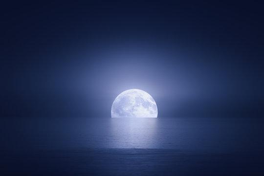 big moon over the sea at night