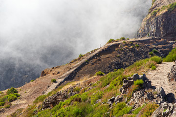 Narrow hiking trails on the mountain Pico do Arieiro. Portuguese island of Madeira