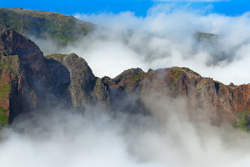 Mountain range in dense clouds. View from Pico do Arieiro on Portuguese island of Madeira