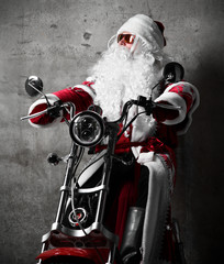 Santa Claus show thumbs up sign sitting on  electric motorcycle bicycle scooter with text copy space