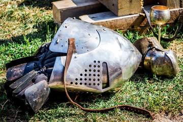The helmet of a medieval warrior on earth after a knight's fight_