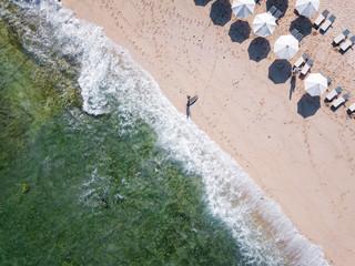 Indonesia, Bali, Aerial view of Balngan beach, surfer at the beach