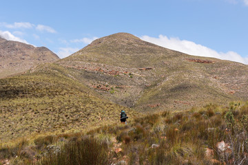 A women hiking the Cockscomb mountains in the Eastern Cape, South Africa. The great outdoors concept background image.