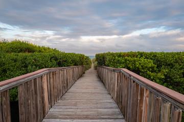wooden bridge at pompano beach with beach access