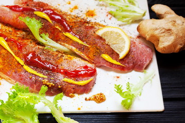 Raw meat, beef steak with spices on whhite background, top view