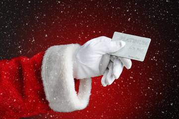 Cyber Monday Concept: Santa Claus Hand Holding Credit Card