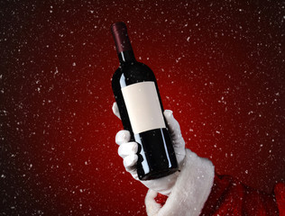 Santa Holding Wine Bottle with Snow Effect