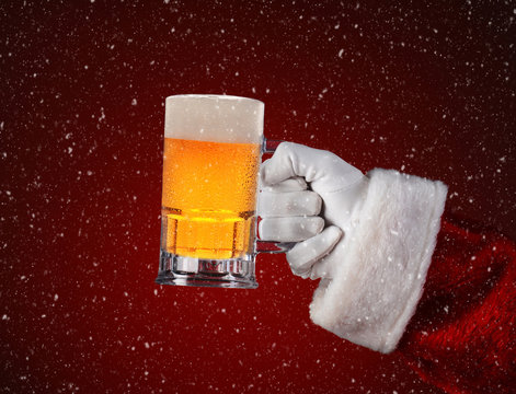 Santa Holding a Mug of Beer Over Red with Snow Effect