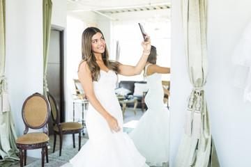 Woman Feeling Beautiful In Wedding Gown