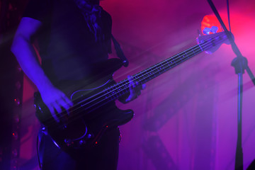 Electric bass guitar player on a stage