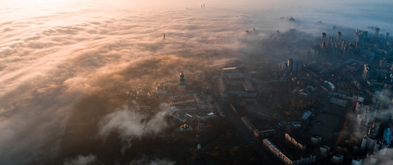 Aerial view of the city in dense fog