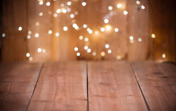 Christmas Bokeh background with empty wooden