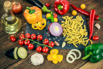 food cooking ingredients on dark background with , top view, Vegetables pasta and spices