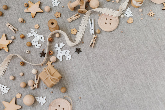 Craft and wooden Christmas flatlay on farbic background.