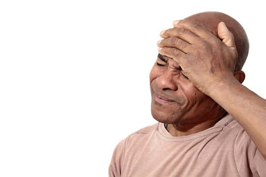 man experiencing strong headache stock photo
