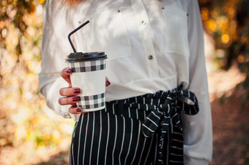 Girl holding cup of coffee