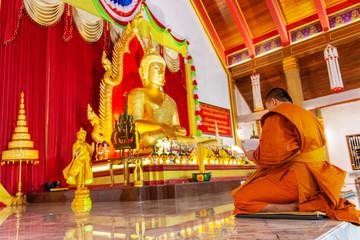 UBONRATCHATHANI, THAILAND - 20 NOVEMBER 2018 : A monk was praying at evening in Mahawanaram temple.