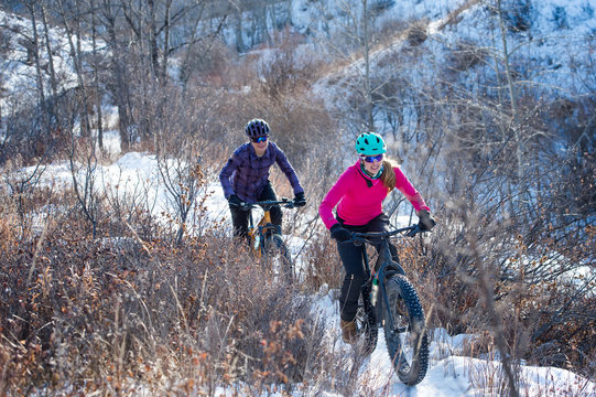 Two Women riding Fat Bikes in the Snow