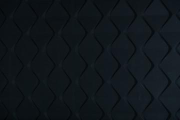 Deurstickers Leder dark black wall with pronounced figured diamond shapes