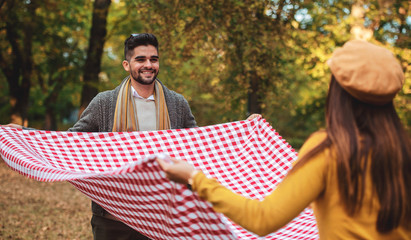 Couple enjoying picnic together. Love and tenderness, dating, romance, lifestyle concept