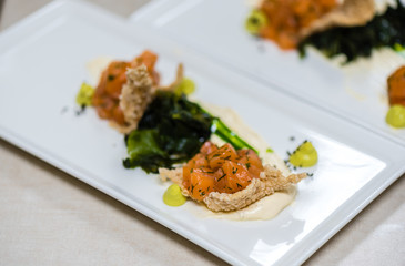 Salmon with vegetables in creamy caviar sauce