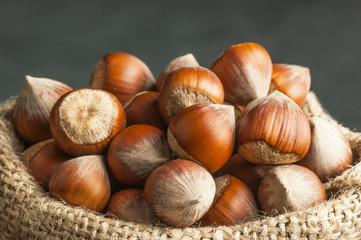 Hazelnuts, filbert in burlap sack. heap or stack of hazelnuts. Hazelnut background, healty food
