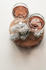 Transparent glass of wine. Pink wine. Festive mood. Alcohol for a group of friends. Delicious drink. Light background. Noble drink. Lavender and rose wine. Wine from lavender