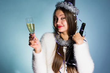 funny drunk girl celebrates the new year, after the corporate, holds a glass of champagne in her hands