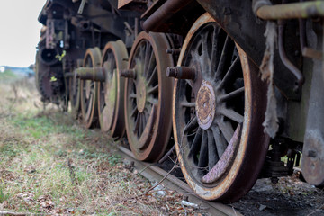 Old destroyed steam engines. Forgotten railway station in central europe.