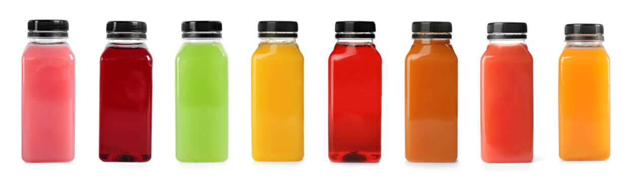 Set with plastic bottles of different juices on white background