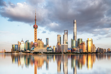 ShangHai,China.Cloudy sunsets, panoramic views of city buildings, reflections on water