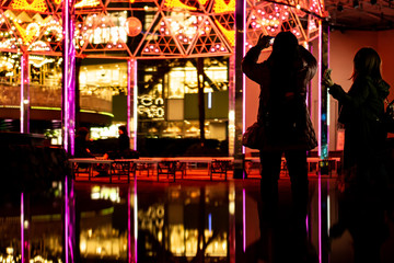Tourists take pictures of Christmas lights in Tokyo, Japan