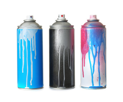 Used cans of spray paint on white background