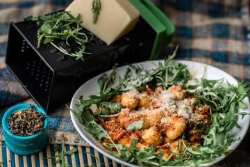 Gnocchi with tomato sauce, cheese and spices