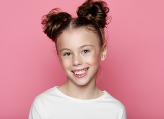 Cute girl 7-8 year old posing in studio over pink background