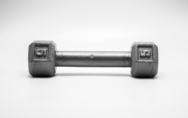 one 5 pound silver weight lifting dumbbell with numbers displayed isolated on white