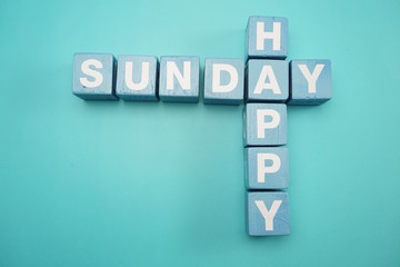 Happy Sunday alphabet letters with space copy on blue background