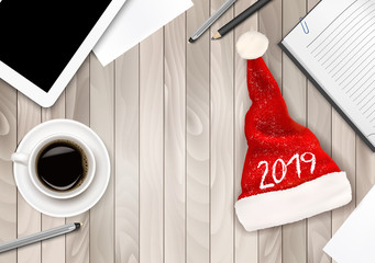 Christmas Office Background with Santa Hat, Tablet and Office Supplies. Business Concept. Vector.