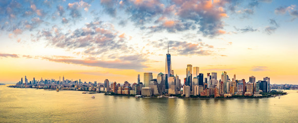 Wall Mural - Aerial panorama of New York City skyline at sunset with both midtown and downtown Manhattan