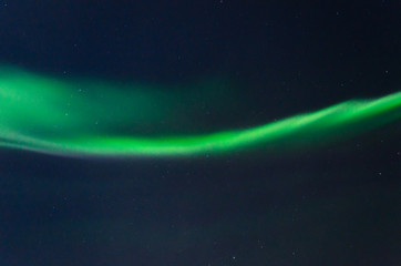 Beautiful stripes of the northern lights, aurora in the night sky.